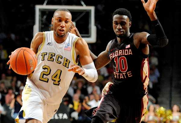 Photo by Austin Foote / Junior forward Kammeon Holsey takes the ball to the basket. Holsey had 13 points in Georgia Tech's win over Virginia Tech.