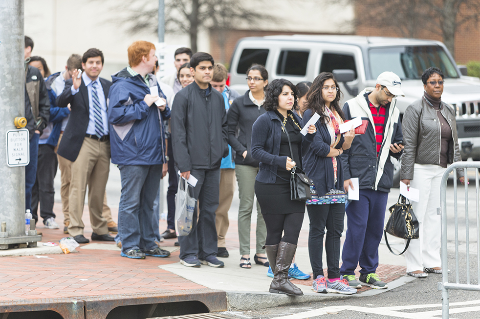 Tech students and faculty stand in line with their tickets to enter McCamish Pavilion early Tuesday morning. Doors for general admission opened at 10 a.m. // Photo by John Nakano