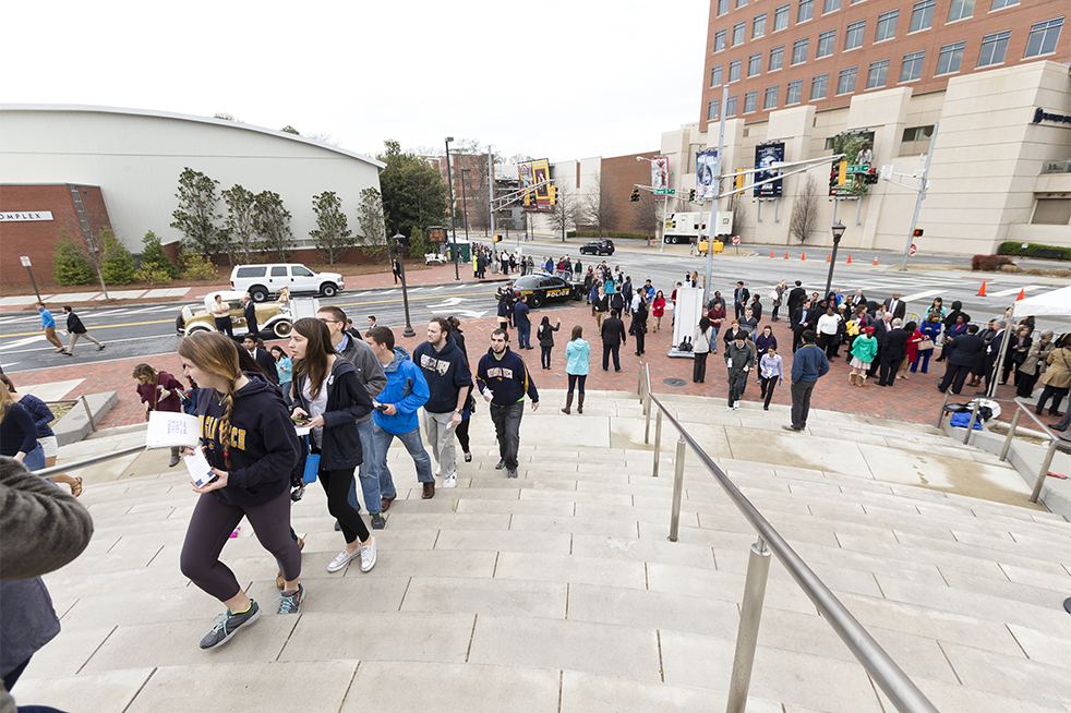 Student walk up the steps to McCamish Pavilion hours before the speech. Some attendees stood in line as early as 4:30 a.m. almost six hours prior the opening of the doors. // Photo by John Nakano