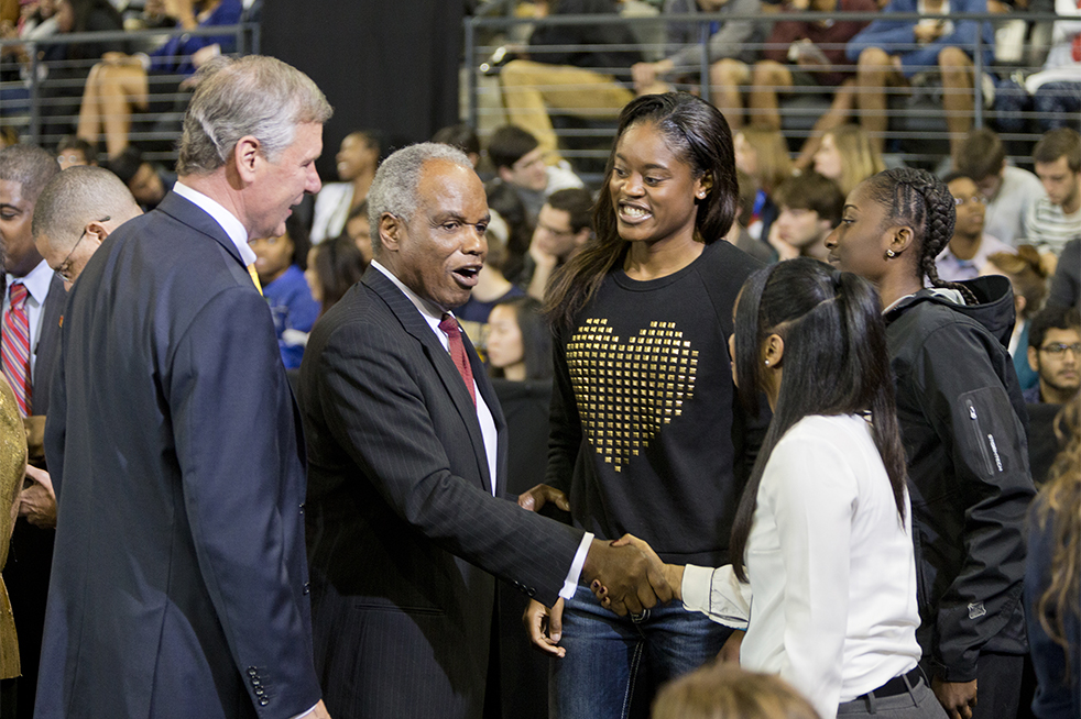 President Bud Peterson and Rep. David Scott greets Tiffany Davis (middle), Kaela Davis (left) and Sydney Wallace (right). Davis and Wallace are members of the Women's Basketball team. // Photo by John Nakano