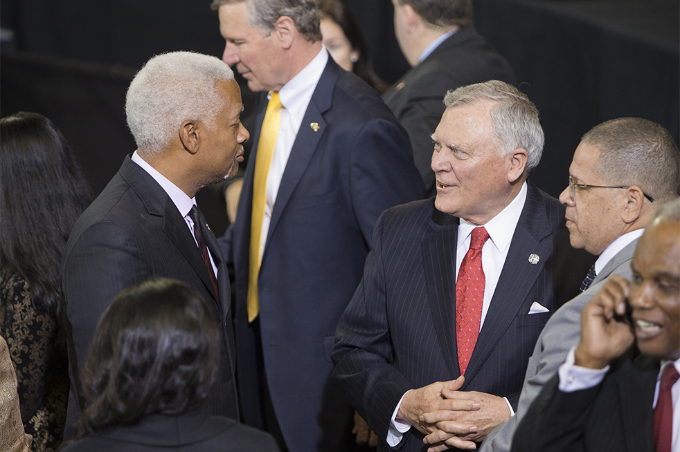 Rep. Hank Johnson speaks to Gov. Nathan Deal prior to President Obama's speech. // Photo by John Nakano