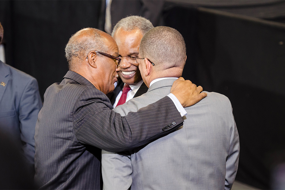 State Rep. Calvin Smyre (left) greets Rep. David Scott (middle) and Fulton County Chairman John Eaves (right). // Photo by Brenda Lin