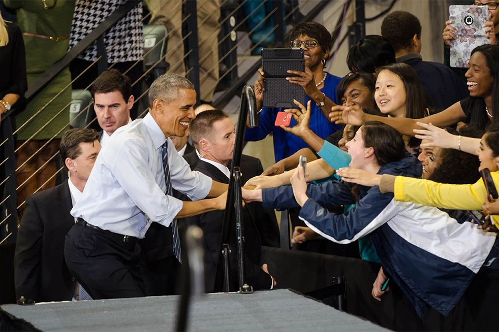 Students reach for a handshakes with President Obama as he walks up the stairs onto the stage. // Photo by Brenda Lin