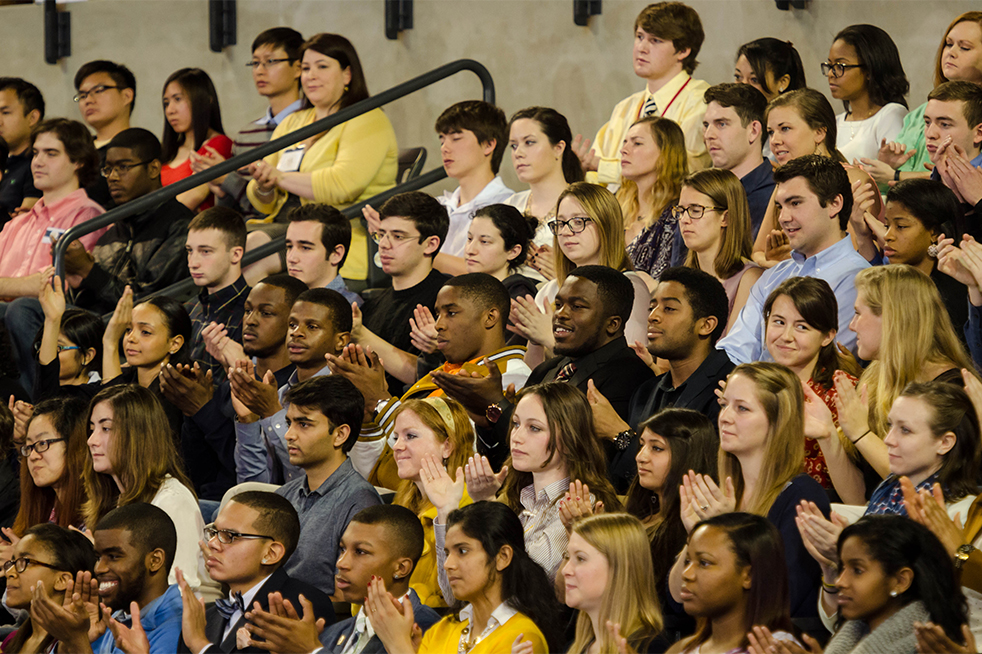 Students sitting in the preferred ticket section applaud for one of the president's points during his speech. // Photo by Brenda Lin
