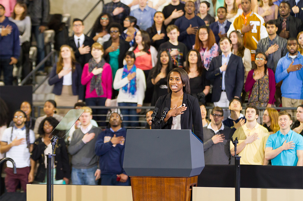 Undergraduate Vice President of Campus Affairs Jennifer Abrams leads the audience in the Pledge of Allegiance. // Photo by Tyler Meuter