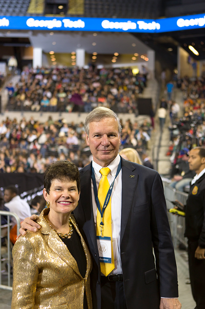 President Bud Peterson and his wife Val were in attendance during President Obama's remarks.  As with many of her other clothes, Val Peterson crafted her own blazer for this event. // Photo by Tyler Meuter
